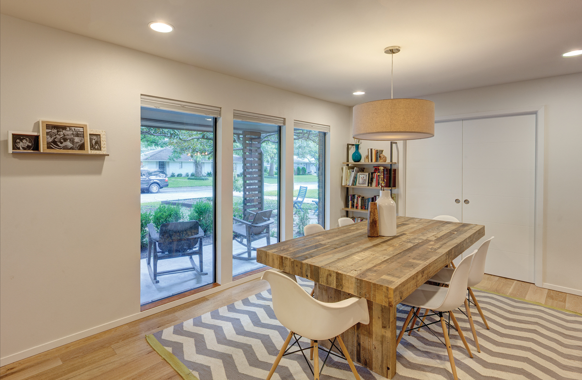 Dining room area with large aluminum windows