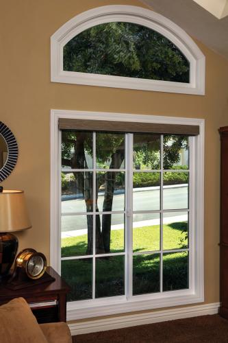Tuscany Series horizontal slider with SDL grids and arch picture window above