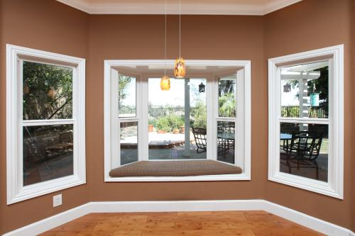 Tuscany Series Bay window with single hung windows to either side