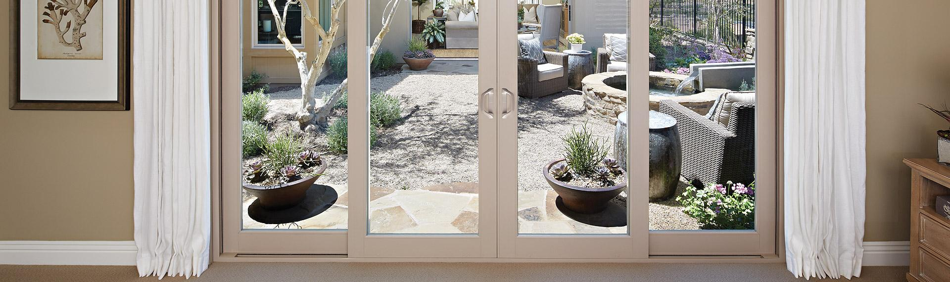 Montecito Series vinyl 4-panel sliding patio door with SmartTouch® handle