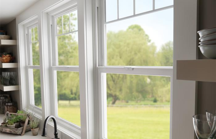 Tuscany Series vinyl double hung windows with valance grid