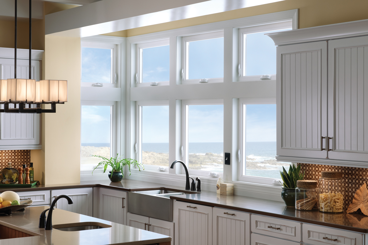 Stacking windows also add light into the room and can be a great focal point, if done correctly. This collection of windows includes awning and casement windows that are stacked to provide maximum natural lighting into the kitchen.