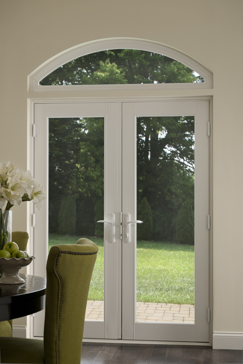 A Tuscany Series In-swing patio door with a transom window attached.