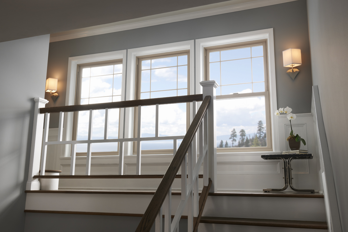 Three Tuscany Series single hung windows on the second floor of a home.